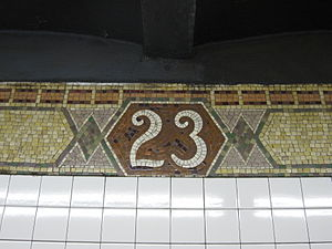 23rd Street (IRT Broadway–Seventh Avenue Line) - Number tablet on trim line
