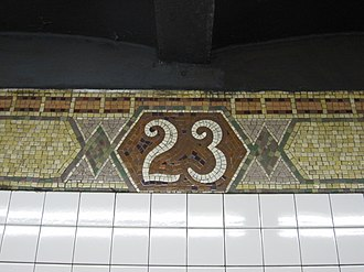23rd Street (IRT Broadway–Seventh Avenue Line) - Number tablet on trim line