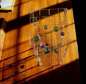3D tic-tac-toe - 3-D Tic-Tac-Toe played with glass beads
