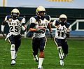 3 Midshipmen players at 2008 EagleBank Bowl 081220-N-0923G-001.jpg