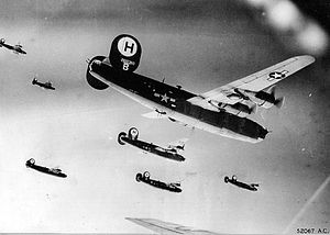 446th Bomb Group Liberators on their way to a target. Identifiable is Ford B-24H-1-FO Liberator Serial 42-7607.