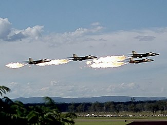 4 RAAF F-111C perform a low-pass dump and burn (1).jpg