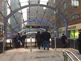96th Street (Second Avenue Subway) - Entrance 3, with blue LEDs lighting up the canopy's supports