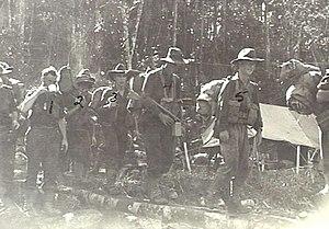 60th Battalion (Australia) - Men from the 57th/60th Battalion advance up the Faria River in February 1944