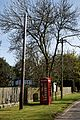 A K6 telephone box and utility poles Little Laver Road Essex England.jpg
