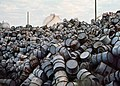 A MOUNTAIN OF DAMAGED OIL DRUMS NEAR THE EXXON REFINERY - NARA - 546000 (cropped).jpg