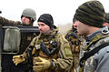 A Norwegian soldier, center, gives instructions during a military adviser team (MAT) and police adviser team (PAT) training exercise at the Hohenfels Training Area, a part of the Joint Multinational Readiness 131212-A-LO967-002.jpg