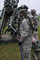 A U.S. Soldier with Charlie Battery, Field Artillery Squadron, 2nd Cavalry Regiment prepares to swab an M777 Howitzer during Saber Junction 2012 near the Joint Multinational Readiness Center in Hohenfels 121024-A-TF309-005.jpg