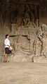 A Viewer Engrossed in the beauty of the carvings in Ellora Cave Temple.jpg