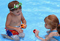 A little boy and a little girl at the pool.jpg