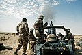A member of the 1st Battalion, 325th Airborne Infantry Regiment, prepares to load a 105mm shell into an M-102 towed howitzer during a heavy artillery barrage demonstration.jpg