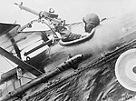 A pilot of an S.E.5a of No. 1 Squadron firing the Lewis Gun on the upper plane of his machine.jpg