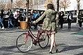 A woman and a bike (35205895041).jpg