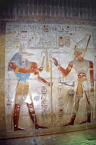 Wepwawet - Wepwawet giving scepters to Seti I found at Temple of Seti I. Wepwawet is often depicted as a bluish or grayish haired wolf or jackal to avoid confusion with Anubis.