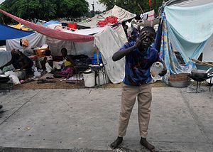Homeless Haitians set up tents nearby the Pres...
