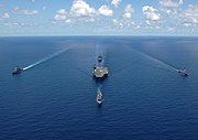 Aerial bow view of George Washington Carrier Strike Group in formation for photo exercise 060429-N-9621S-014