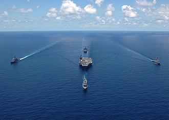 "Carrier battle group - USS George Washington Carrier strike group sails in formation for a strike group photo in the Caribbean Sea April 29, 2006. Such a formation, referred to derisively as the ""bullseye"" formation, would not be used in combat."