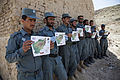 Afghan Uniform Police officers display their certificates for completing evidence collection training at Forward Operating Base Zeebrugge in Kajaki, Afghanistan, April 27, 2013 130427-M-QZ858-106.jpg