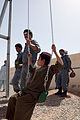 Afghan police build swing set for boys school 120517-M-DM345-020.jpg