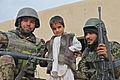 Afghan soldiers pose for a picture with a local Afghan boy, center, at a qalat in the Chingay village, Sayed Abad district, Wardak province, Afghanistan, Nov. 21, 2011 111121-A-BZ540-045.jpg