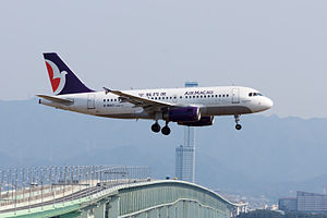Air Macau - Airbus A319-100 B-MAO landing at Kansai International Airport, Japan.