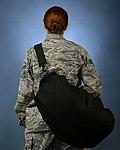 Airman wearing a gym bag.jpg