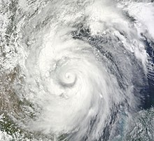 Satellite imagery of a mature hurricane progressing west-northwest towards the coastline of Mexico.