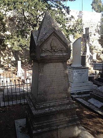 Michael Alexander (bishop) - Alexander's grave, in the back Nicolayson's adorned with a truncated column