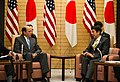 Ambassador Roos with Prime Minister Abe at the Joint Press Announcement of the Okinawa Consolidation Plan (8620840769).jpg