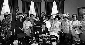 Second-wave feminism - American Association of University Women members with President John F. Kennedy as he signs the Equal Pay Act into law in 1963