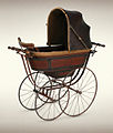 An Early Silver Cross Coach-Built Pram.jpg