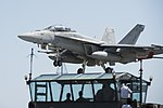 An F-A-18E Super Hornet practices a touch-and-go landing during field carrier landing practice at Iwo To, Japan. (27049558775).jpg