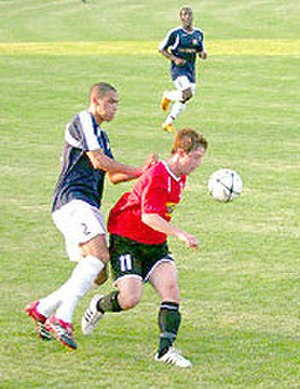 Andover F.C. - Andover's Michael Turvey (in red) in action against Salisbury City in a pre-season friendly played on 22 July 2008 to mark the club's 125th anniversary