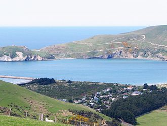 Aramoana - Looking east across the mouth of Otago Harbour; Aramoana settlement to the lower right