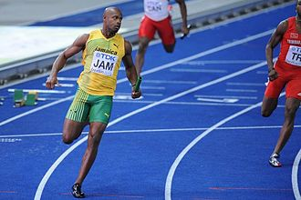 Asafa Powell - Powell anchoring the Jamaican relay team to a World Championship gold medal