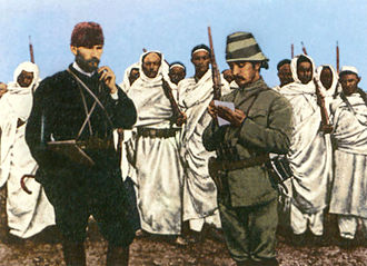 Causes of World War I - Mustafa Kemal (left) with an Ottoman military officer and Bedouin forces in Derna, Tripolitania Vilayet, 1912