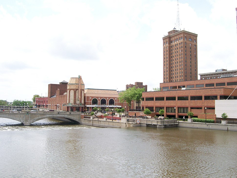 The Fox River and Galena Boulevard dam, Paramount Theatre, Aurora Riverwalk, Civic Center, and Leland Tower