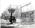 Automobile fueling at one of the first gas stations in St. Louis, operated by the Pierce Oil Company at 4614 Washington Boulevard, 1916.jpg