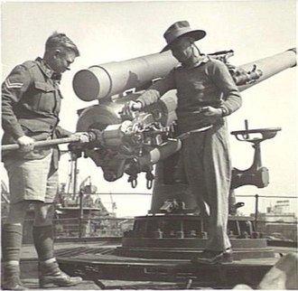 BL 4 inch Mk IX naval gun - Cleaning the breech on transport St Essylt, Suez 1942