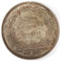 Baksida av medalj med bild av lagerkrans samt text - Skoklosters slott - 99270.tif