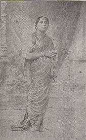Black and white photograph of a woman in nine-yard saree.