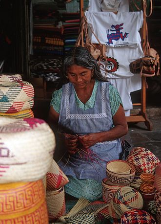 Basketry of Mexico - Woman weaving a basket in the Benito Juarez Market in the city of Oaxaca