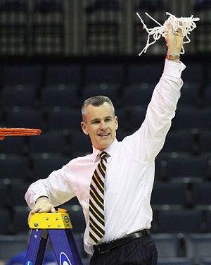 Billy Donovan - Donovan cutting the net after the Gators beat Dayton in the Elite Eight