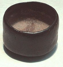 Photo of a tea bowl, dark-coloured, humble, and asymmetric