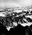 Blockade Glacier, aretes seperating tributaries to valley glacier, and hanging glaciers on the surrounding mountainsides, August (GLACIERS 6419).jpg