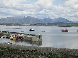Boats and mountains, Roundstone (6047965086).jpg