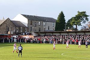 Scottish Cup - Junior club Bonnyrigg Rose (in red) qualified to compete by winning the SJFA East Superleague in 2012.