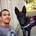 Brandon McMillan and service dog, Atlas.jpg