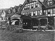 Porch and porte-cochère of a Tudor Revival hotel