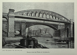 Monkwearmouth Railway Bridge - The bridge as built (from The Engineer, 1880). The 1857 reconstruction of the 1796 Wearmouth Bridge is to the rear